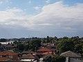 Sydney skyline from the western suburbs.jpg