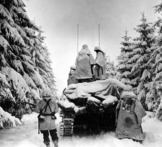 82nd Airborne Division - Men of the 504th Parachute Infantry Regiment advancing through a snow-covered forest during the Battle of the Bulge, December 1944.
