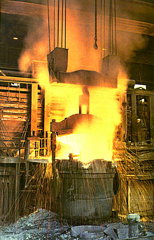 Open furnace in use, with sparks flying