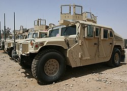 A group of Humvees lined up in a row.