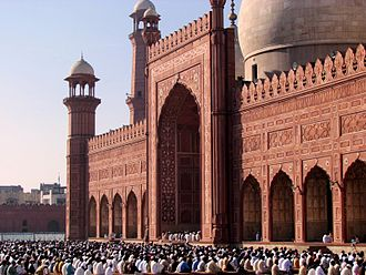 Islam in Asia - The Badshahi Mosque in Lahore, Pakistan during Eid al-Fitr. It is the largest moque in South Asia