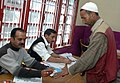 The Polling official administering indelible ink at the finger of a voter at a polling booth in DAV Sr. Sec. School, Lakkar Bazar, Shimla, during the 5th and final phase of General Election-2009, in Himachal Pradesh.jpg