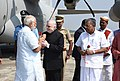 The Prime Minister, Shri Narendra Modi being welcomed by the Governor of Kerala, Justice (Retd.) Shri P. Sathasivam and the Chief Minister of Kerala, Shri Pinarayi Vijayan, on his arrival, at Trivandrum, Kerala.jpg