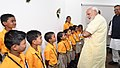The Prime Minister, Shri Narendra Modi interacting with the school children, at the inauguration of the Integrated Command & Control Centre, at Naya Raipur, Chhattisgarh.JPG