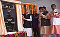 The Prime Minister, Shri Narendra Modi unveiling the foundation stone for the redevelopment of Gandhinagar Railway Station Complex, in Gujarat.jpg