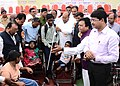 The Union Minister for Social Justice and Empowerment, Shri Thaawar Chand Gehlot distributing the aids and assistive devices to the persons with disabilities, in Amaravati, Maharashtra on February 14, 2016.jpg