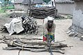This woman is preparing fire wood to market.jpg
