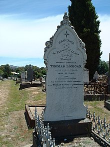 Large white headstone with the details of Lonigan's death