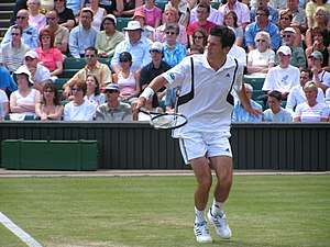 Tim Henman - Henman playing a backhand at Wimbledon, 2004
