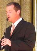 Photo of Todd Newton hosting the live-on-stage edition of the Price is Right at the Jubilee theater in Las Vegas, 2010.