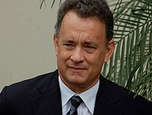 Hanks standing at a podium