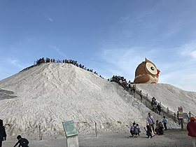 Tourists climbing Qigu Salt Mountain.jpg