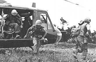 Air assault -  Troops dismounting a UH-1 during the Vietnam War.