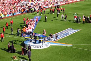 Patrick Vieira - Vieira (centre, on podium) lifting the Premier League trophy in May 2004.