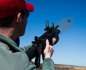U.S. Air Force Senior Airman Alfred Vassallo, a combat arms training and maintenance instructor with the 11th Security Forces Group, fires an M203 grenade launcher during heavy weapons qualification March 4 130304-F-MG591-006.jpg