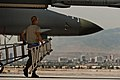 U.S. Air Force Senior Airman Matthew Crow, a crew chief with the 7th Aircraft Maintenance Squadron, carries a ladder to work on a B-1B Lancer aircraft during Green Flag-West (GFW) at Nellis Air Force Base, Nev 130521-F-AQ406-152.jpg