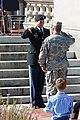 U.S. Army 2nd Lt. David Keeven, background, receives his first salute as a second lieutenant from Sgt. 1st Class Anthony Kennedy during a commissioning ceremony Sept 140927-Z-DW047-217.jpg