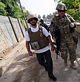 U.S. Army Lt. Col. Anthony Ulrich, right, the civil affairs commander with the Farah Provincial Reconstruction Team (PRT), arrives for a meeting with the chief prosecutor in Farah, Afghanistan, Aug. 29, 2012 120829-N-II659-0832.jpg