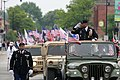 U.S. Army Reserve Brig. Gen. Gracus K. Dunn, commanding general of the 85th Support Command and deputy commanding general for support of First Army Division West, renders a salute from a parade vehicle, during 130527-A-KL464-053.jpg
