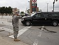 U.S. Army Sgt. Rhea Moore, with the 180th Cavalry Regiment, Oklahoma Army National Guard, salutes President Barack Obama's motorcade in Moore, Okla., May 26, 2013 130526-Z-VF620-4215.jpg