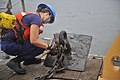 U.S. Coast Guard Seaman Dani Wilson, assigned to Aids to Navigation Team Milford Haven, disconnects chain from a sinker aboard a 55-foot aids to navigation boat in Hills Bay near the station in Hudgins, Va 130801-G-RU729-834.jpg