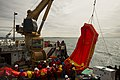 U.S. Coast Guardsmen aboard USCGC Sycamore (WLB 209) recover a spilled oil recovery system during Arctic Edge 2012 near Barrow, Alaska, Aug. 1, 2012 120801-F-WT312-999.jpg