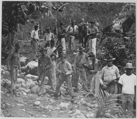U.S. Marines and guide in search of Haitian Cacos fighters against the U.S. occupation of Haiti, c.  1919 U.S. Marines and guide in search of bandits. Haiti, circa 1919., 1927 - 1981 - NARA - 532584.tif