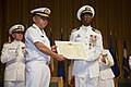 U.S. Navy Capt. Pius Aiyelawo, outgoing commander, U.S. Naval Hospital Okinawa, right, recieves a letter of appreciation from Rear Adm. Shigeaki Yanagida, Surgeon General and Director of Medicine, Japan Maritime 130718-M-DG262-039.jpg