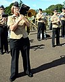 U.S. Navy Musician 1st Class Jennifer Wilson, left, plays a trombone in the U.S. Naval Forces Europe Band during a rehearsal for the massed military band portion of the Royal Edinburgh Military Tattoo 120731-N-VT117-1065.jpg