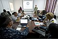 U.S. Navy Petty Officer 2nd Class Marcus Loen, standing right, briefs representatives from Somalia, Sudan, Djibouti, the Netherlands and the United States during Cutlass Express 2013 at the Port of Djibouti 131111-F-NJ596-019.jpg