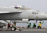 U.S. Sailors prepare an F-A-18E Super Hornet aircraft assigned to Strike Fighter Squadron (VFA) 147 for launch from the aircraft carrier USS Nimitz (CVN 68) June 19, 2013, in the Gulf of Oman 130619-N-GA424-011.jpg