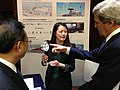 U.S. Secretary of State John Kerry and Chinese State Councilor Yang Jiechi explore interactive exhibits highlighting energy and environmental projects by U.S. and Chinese companies in Beijing, China, on April 13, 2013.jpg