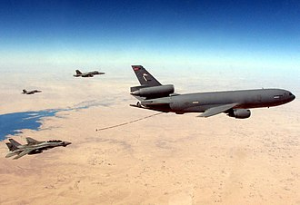McDonnell Douglas KC-10 Extender - A USN F-14D and two F/A-18Cs prepare to refuel from a KC-10 in 2005 over the Persian Gulf.
