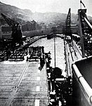 USS Cabot (CVL-28) enters a dry dock in Gibraltar, in early 1952.jpg