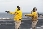 USS Carl Vinson EO directs aircraft 141101-N-HD510-020.jpg
