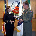 US Navy 021203-N-7393N-001 Ensign Daniela Giordano accepts her winging certificate.jpg