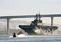 US Navy 030117-N-3211R-001 The amphibious assault ship passes under the Coronado bridge as she makes her way out of the San Diego Bay.jpg