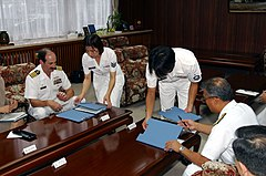 US Navy 030623-N-0000F-001 Vice Adm. Takashi Saito, Commandant, Yokosuka District Japanese Maritime Self Defense Forces (JMSDF), and Capt. Michael Seifert, Commanding Officer Fleet Activities Yokosuka, sign a Memorandum of Unde
