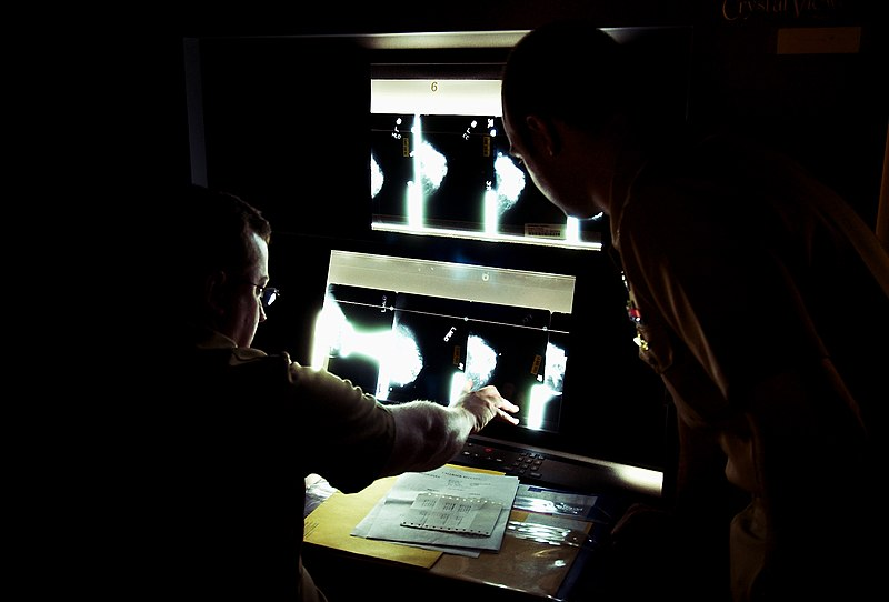 File:US Navy 030820-N-9593R-007 U.S. Navy doctors Lt. Cmdr Ralph Pickard, left, and Ens. Jesse Rohloff study a patient's mammogram film at the National Naval Medical Center in Bethesda, Maryland.jpg