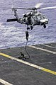 US Navy 031017-N-2143T-002 Explosive Ordinance Disposal Mobile Unit Eleven Detachment One (EOD MU11 DET 1) fast ropes out of a HH-60H Seahawk.jpg