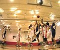 US Navy 040309-N-3874J-008 Players from the All-Navy and Marine Corps Women's basketball teams fight for a rebound.jpg