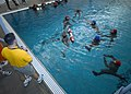 US Navy 041208-N-4385W-034 Sailors assigned to Explosive Ordnance Disposal Mobile Unit Eleven (EODMU-11), tread water during a water survival training exercise.jpg