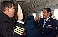 US Navy 050420-N-6997B-002 Commanding Officer, Naval Air Facility Misawa, Capt. Wayne Radloff, reenlists U.S. Air Force Senior Airman Abigail Foster, assigned to the 35th Mission Support Squadron, while flying aboard a C-12 Hur.jpg