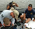 US Navy 050816-N-1722M-243 Aviation Ordnanceman 1st Class Rich Steele, assigned to Explosive Ordnance Mobile Unit Twelve (EODMU-12), Detachment 10, conducts a safety check on diver Chief Hull Technician Jeff Bailey.jpg