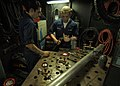 US Navy 050902-N-4308O-004 Hull Technician Fireman Steven Irwin, left, and Hull Technician Fireman Chance Brooks weld stanchions to a potable fresh water manifold in the Machine Shop aboard the Nimitz-class aircraft carrier USS.jpg