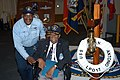 US Navy 060504-N-1561L-002 Ships Serviceman Vincent Ibiam, left, poses for a photo opportunity with visiting Tuskegee Airman retired Lt. Col. Charles Dryden, Sr., during Recognition Day Fleet Week USA events aboard USS San Anto.jpg