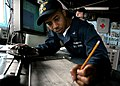 US Navy 060504-N-4953E-029 Quartermaster 3rd Class Carrin Johnson assigned to the guided-missile destroyer USS Stethem (DDG 63), plots the ship's course. Stethem is currently participating in Multi-Sail 2006.jpg