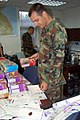 US Navy 060614-N-4208W-006 Gunner's Mate 1st Class Keith Anderson picks up his box of Girl Scout cookies and a special note in the Commander Naval Forces Korea Headquarters as a part of Operation Thin Mint.jpg