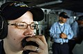 US Navy 060622-N-4776G-070 Operations Specialist 2nd Class Katrin Menthe from Fayette, Maine, mans the phone lines on the bridge of the Nimitz-class aircraft carrier USS Ronald Reagan (CVN 76).jpg