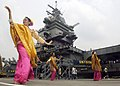 US Navy 060816-N-9742R-135 Traditional Malaysian dancers perform for crew members of the nuclear-powered aircraft carrier USS Enterprise (CVN 65) on the pier during a scheduled port visit in Malaysia.jpg